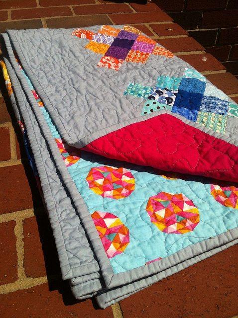 granny square quilt folded.