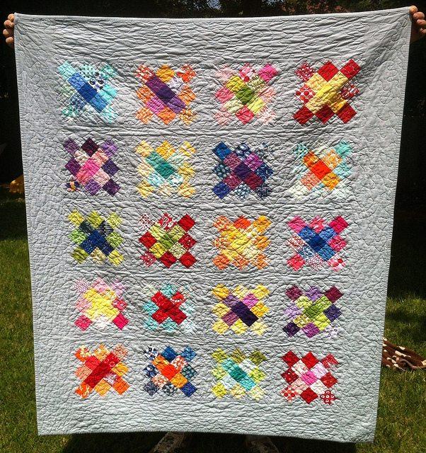 scrappy granny square quilt.